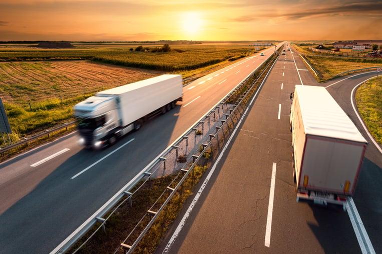 bigstock-Two-Trucks-On-Highway-In-Motio-70870492.jpg