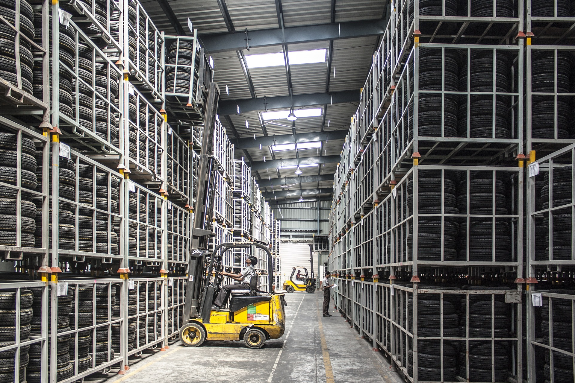 A worker operation a forklift - Inventory system for small business