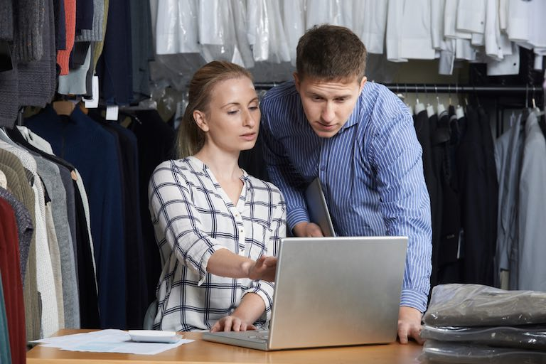A couple using wholesale inventory management software