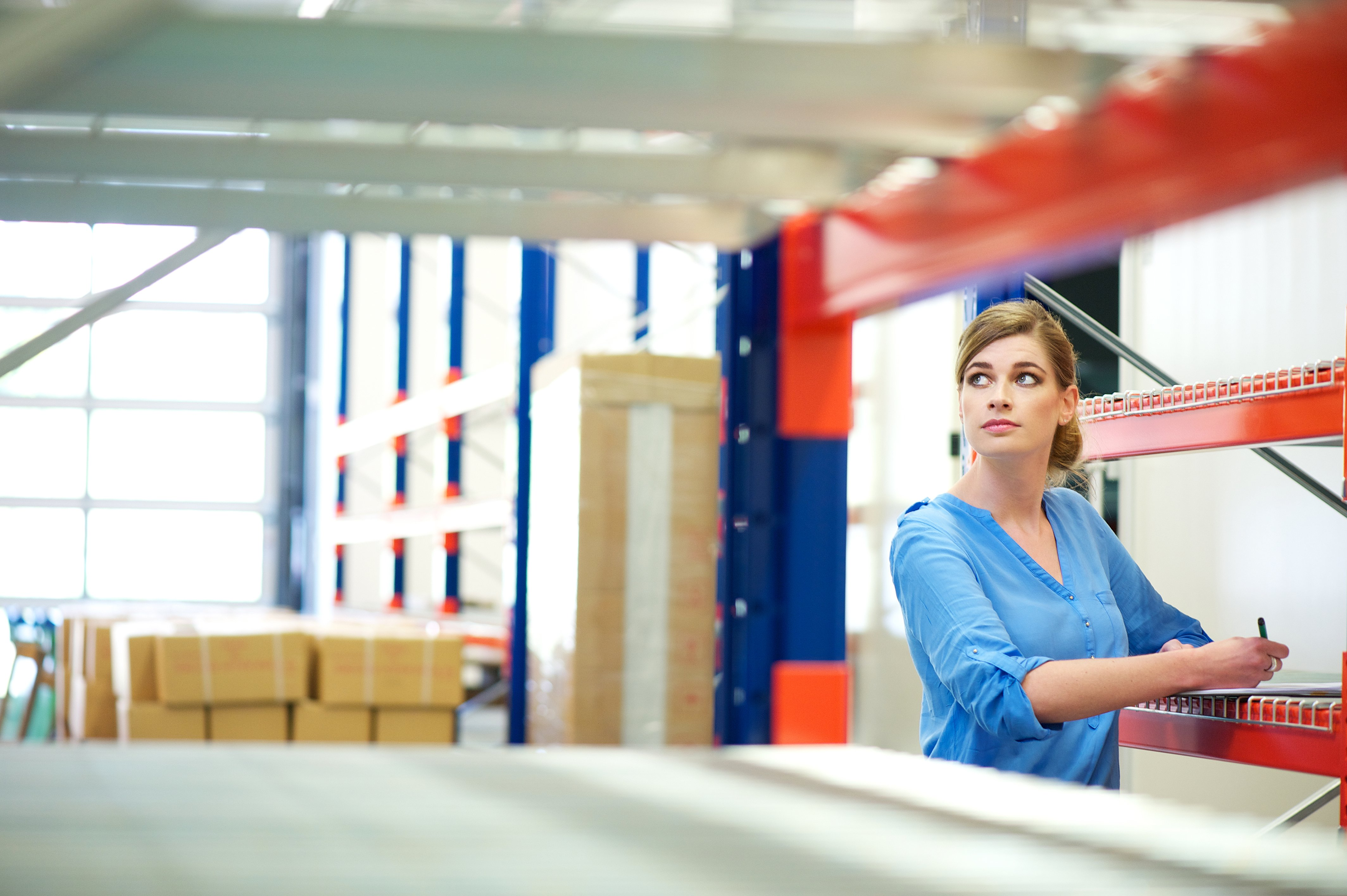 woman doing inventory management in a warehouse