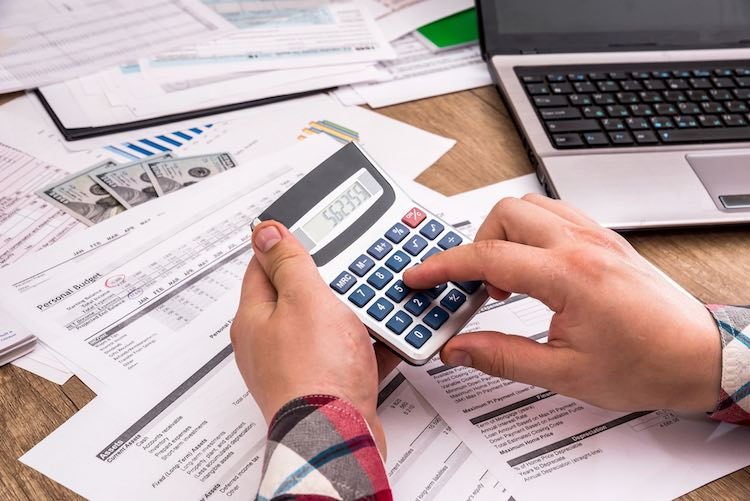 small business owner reconciling payments.jpg